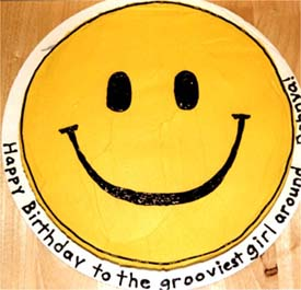 http://www.reasontoparty.com/smiley_cake2.jpg